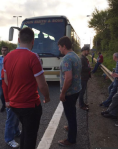 PULL OVER: Fans stop on the motorway.